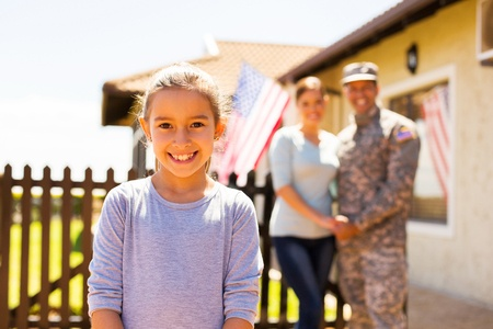 Veteran Family in front of Home